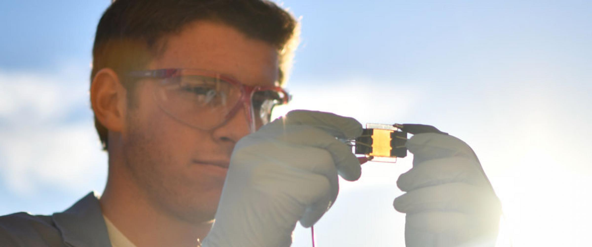 A Chemistry student tests a solar cell